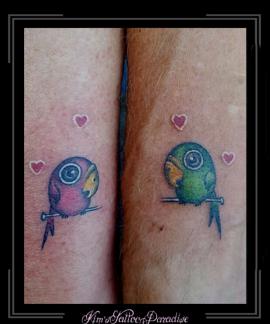 kissing birds love tattoo