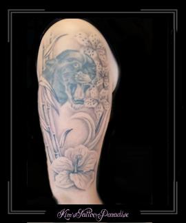 panter bovenarm met lotus en bamboe