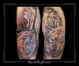 wolf beer bomen bos bovenarm