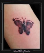 baby voetjes vlinder arm