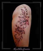 bloemen lelies bovenbeen