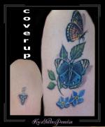 coverup tribal bloemen vlinders bovenarm