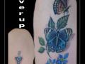 coverup-tribal-bloemen-vlinders-bovenarm-2