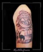 kompas herten in bos arm