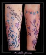 tekst elfjes zwaluwen vogels krullen onderarm