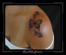 vlinder en kriebel schouder