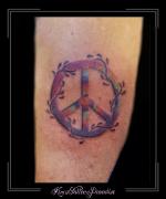 vredesteken symbool logo bovenarm