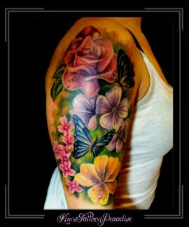 vlinders bloemen bovenarm